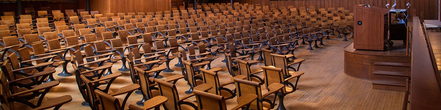 empty desks in a lecture hall