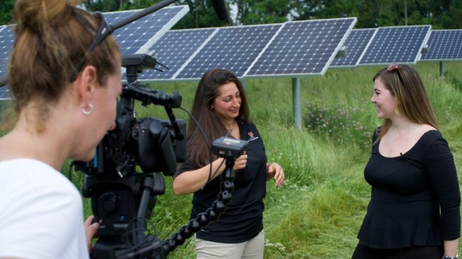 Graduate student Caitlin Harvey at a location shoot in Princeton's solar field.