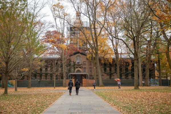 campus life in front of Nassau Hall during fall foliage